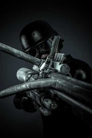soldier of the future with huge laser gun and cannon, pointing photo