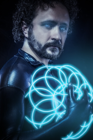 fantasy and science fiction, futuristic soldier dressed in black latex with blue neon spheres photo