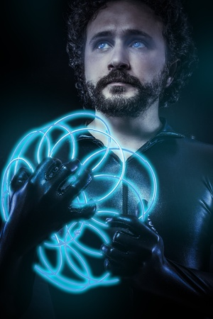 fantasy and science fiction, futuristic soldier dressed in black latex with blue neon gun, blue eyes photo