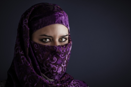 Arab women with traditional veil, eyes intense, mystical beauty photo