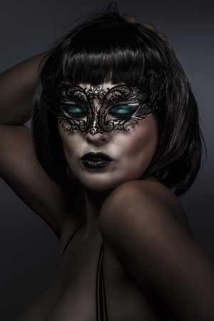 beautiful brunette with short hair and Venetian mask, cabaret photo