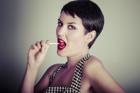 Vintage woman eating a lolly pop photo