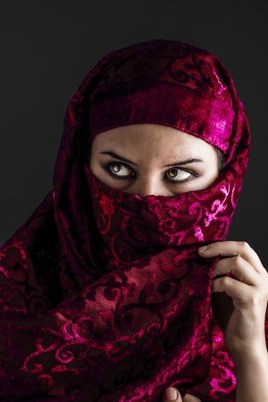 Arab women with traditional red veil, eyes intense, mystical beauty photo