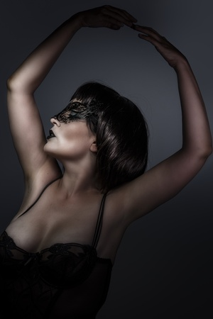 Dancing, Doll, beautiful brunette with short hair and Venetian mask, cabaret photo