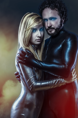 Lovers, couple of super heroes in latex dress photo
