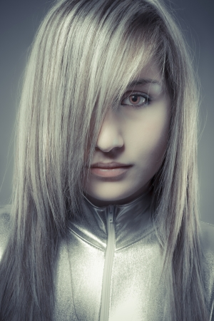 Serious young blond, concept future and modernity, girl with sweet face photo