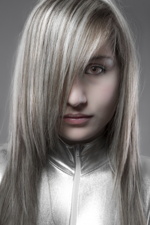 cyber girl: Serious blond, concept future and modernity, young girl with sweet face
