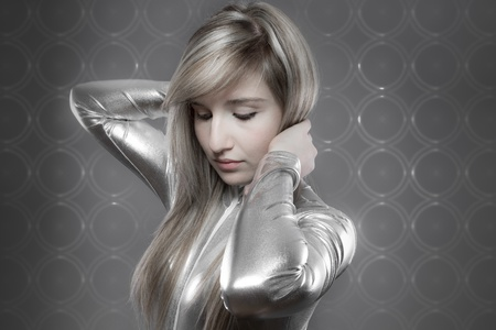 modern concept, beautiful blonde with silver effects, communication and Internet photo