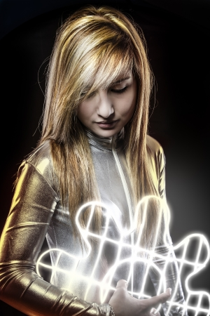 Fiber optics concept, future blonde dressed in silver photo