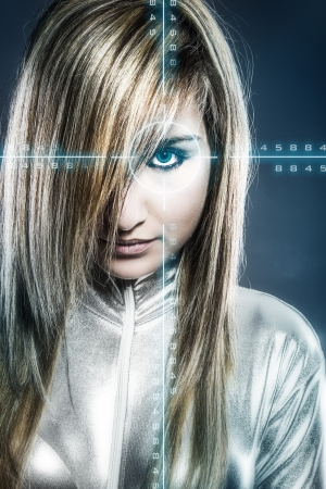communications concept, young blonde with silver latex jumpsuit blue signs Stock Photo