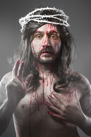 Jesus Christ with a halo of white light over grey background photo