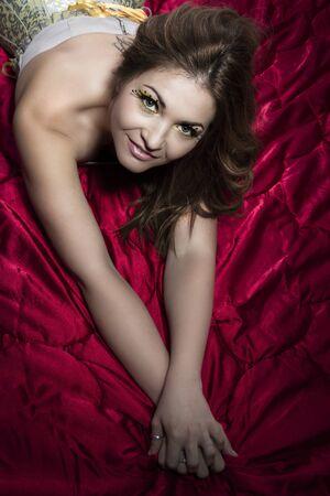 mischievous: beautiful woman smiling and mischievous Stock Photo