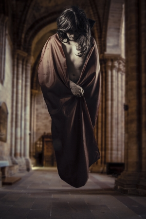 magician levitating inside a Gothic cathedral