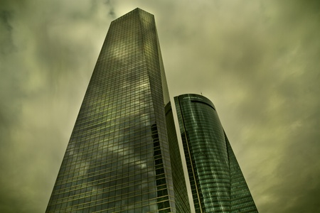 Madrid, clouds reflect on crystal skyscraper, spain, green lights photo