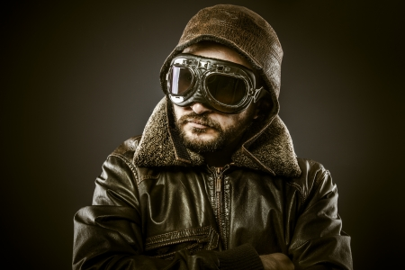 Fighter pilot with hat and glasses era, vintage photo