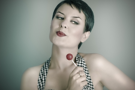 20s woman with lolly pop, pin up style photo