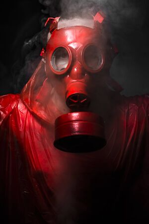 gas man: War concept, man with red gas mask.