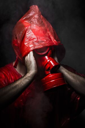 gas man: Army concept, man with red gas mask.