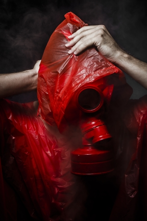 Toxic horror concept, man with red gas mask. photo