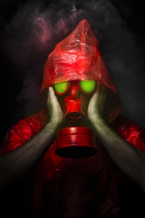 Toxic military concept, man with red gas mask. photo