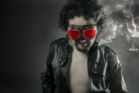 Man with leather jacket and smoke coming out of your body heat concept, sexy anger photo