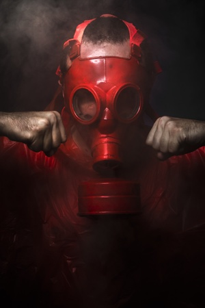army gas mask: Chemical concept, man with red gas mask. Stock Photo