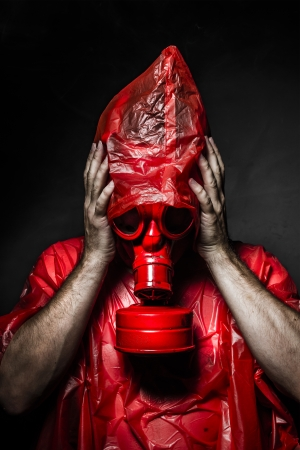 Horror concept, man with red gas mask. photo