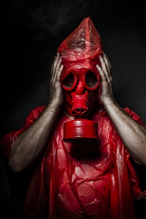 Military concept, man with red gas mask. photo