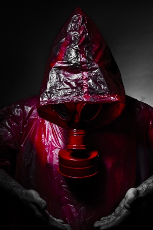 Toxic military concept, man with red gas mask. Stock Photo - 21135306