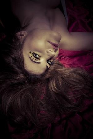 luxuriate: Spanish beautiful woman, lying in red bed