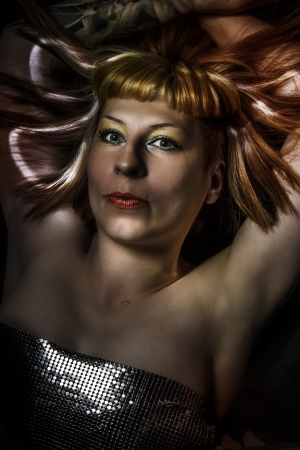blond woman with fiber optics and light effects on her skin photo