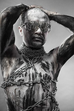 bodybuilding boy: Man covered in bandages and wounds, chained Stock Photo