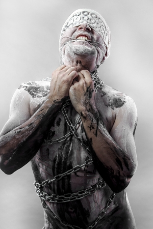 Pain, Bondage, man covered in bandages and wounds, chained photo