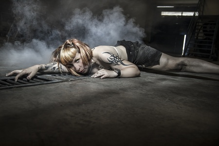 sensual woman in a warehouse photo