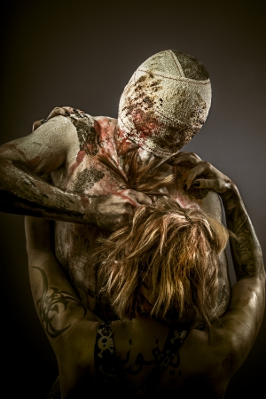 Violence concept, couple with wounds and bandages photo
