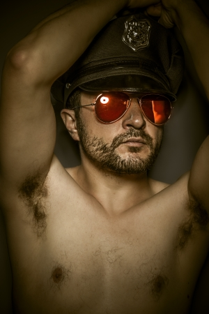 sexy police: Sexy police,  man with cap and red mirror glasses