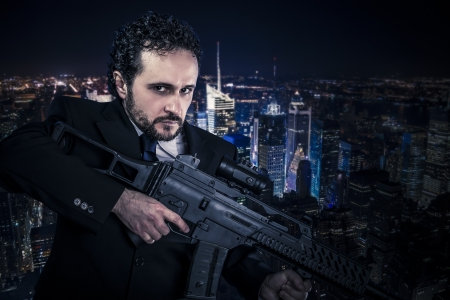 Dangerous business man  concept, armed  with machine gun photo