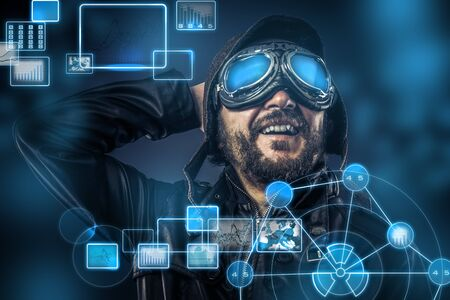 Steampunk concept, happy pilot vintage with big glasses, posing, electronic console photo