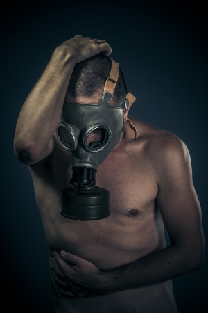 Safety concept, nude man with gas mask photo