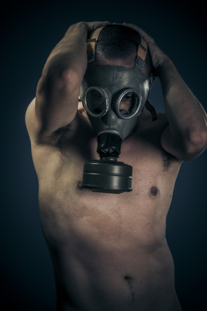 Toxic concept, nude man with gas mask photo