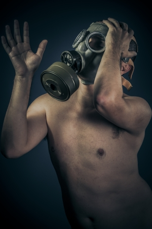 Radiation concept, nude man with gas mask photo