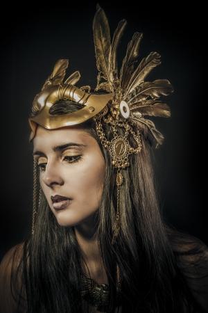 enchanting: sensual woman with golden tiara, ancient goddess