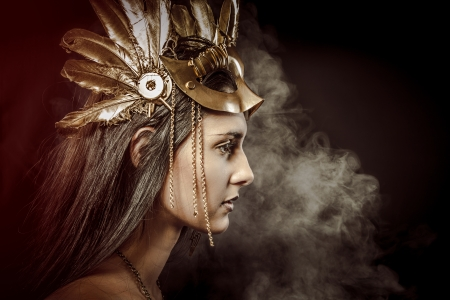Fairy Queen, young with golden mask, ancient goddess photo