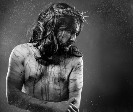 priest: Jesus Christ calvary, man bleeding, representation of passion with crown of thorns Stock Photo