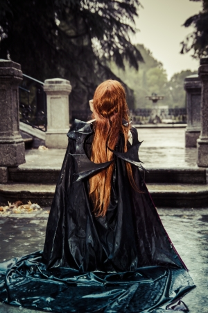 Under the storm, Beautiful vampire woman in palace gate, gothic fantasy photo
