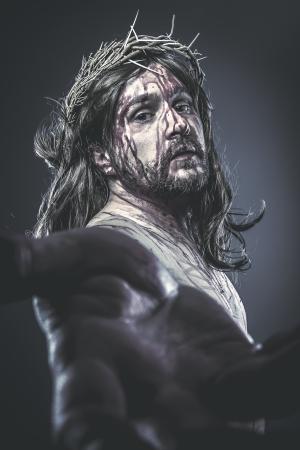 Jesus Christ calvary, man bleeding, representation of passion with crown of thorns Stock Photo