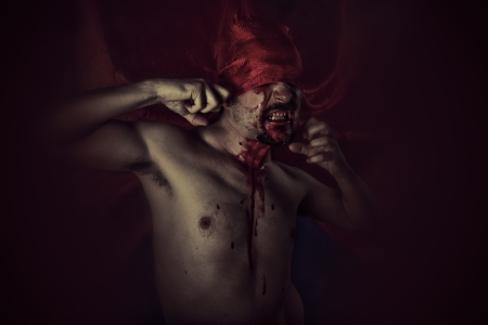 Blood, Scary, Male vampire with huge red coat and blood photo