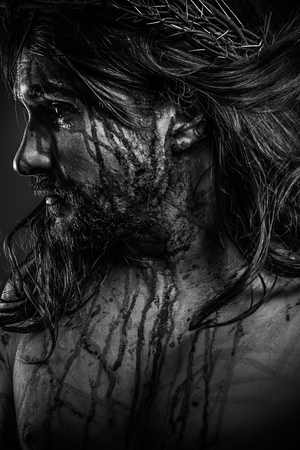 Jesus Christ calvary, man bleeding, representation of passion with crown of thorns photo