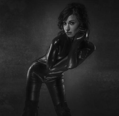 latex woman: Young sexy latex woman on artistic grey background