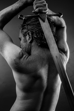 ancient warrior: Wild Warrior with huge metal sword Stock Photo